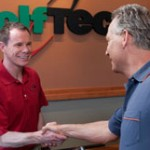 A photo of a Golf Tec employee and customer.