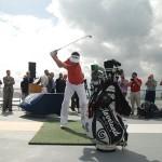 Keegan Bradley swings at the golf ball.