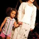 Jesica and Jordan appeared several times on the runway at the CWS. On this turn, Jesica wears upscale resort wear from Cabana Gauze and Jordan wears pink shorts with coordinating striped shirt from Angels and Rascals.