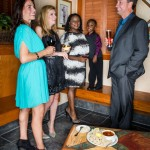 Andy Lowe, Kristi Tolley and Jewel Davey, all members of the management team for Mount Pleasant Towne Centre are joined by Deona Smith, publisher of Living Roots Magazine and her son, Joseph, at Carrabba's in Mount Pleasant. The women, all with Clinique make-up, pose with shoe styles, such as Jessica Simpson, Nine West and Michael Kors, only available at Belk in Mount Pleasant Towne Centre.