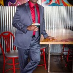 Jermaine Rivers, owner of Dollar World on Daniel Island, wears a Madison gray suit and black Kenneth Cole shoes at Triangle Char & Bar in Mount Pleasant. Clothing provided by Belk in Mount Pleasant Towne Centre.