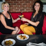 Denise James, managing editor of Mount Pleasant Magazine joins Michele for the well-known shrimp n' grits appetizer and drinks on the comfortable patio at Triangle Char & Bar in Mount Pleasant. Denise is wearing black chiffon, V-neck top with bell sleeves and mustard capris by Michael Kors. Styling and make-up provided by Belk in Mount Pleasant Towne Center.
