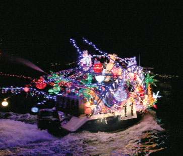 the holiday parade of boats gets people in the mood for the holiday season - Mount Pleasant Christmas Parade