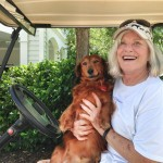 Sally Walker, a professional dog walker and real estate agent, basks in the open, friendly golf cart culture.