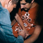 Shepard Fairey signs Anthony Macchio's T-shirt