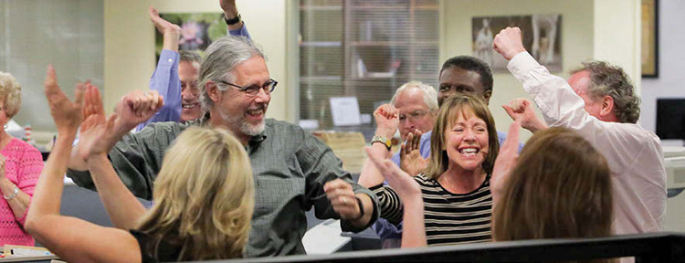 "The staff of The Post and Courier erupt in cheers after hearing that the newspaper was awarded the Pulitzer Prize in Public Service for the series, ""Till Death Do Us Part,"" written by Glenn Smith, Doug Pardue, Jennifer Berry Hawes and Natalie Caula Hauff."