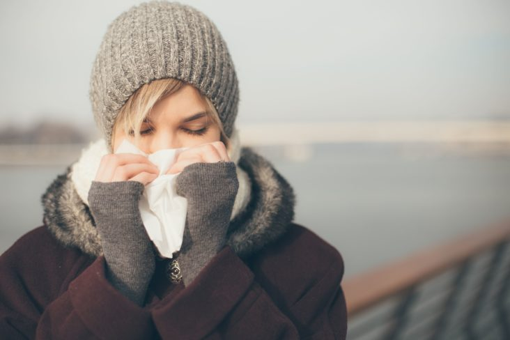 Charleston Allergy and Asthma: a woman during winter caring for her runny nose