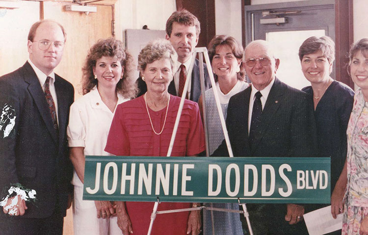 The Dodds family at the dedication of Johnnie Dodds Boulevard. Left to right: Robert Dodds, Joan Dodds, Flo Dodds, John Dodds III, Marilyn Davey, Mayor Johnnie Dodds, Carolyn Nason and Cathy Joyner.