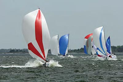 Sperry Charleston Race Week 2017, colorful keelboats in Charleston Harbor