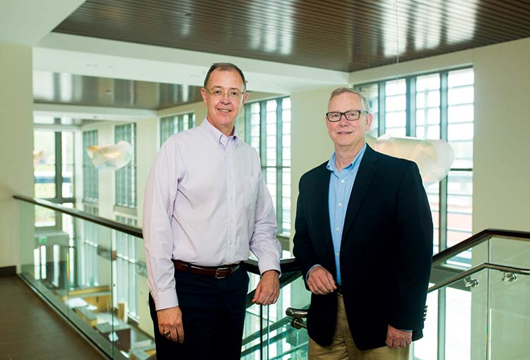 Architect Sam Herin, left, and Dennis Knight of Whole Building Systems were among the professionals who played a key role in creating a state-of-the-art, energy efficient Town Hall.
