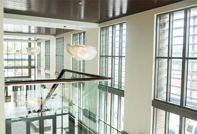 Grand light fixtures, modeled after the shape of jellyfish, dangle from the high ceilings.