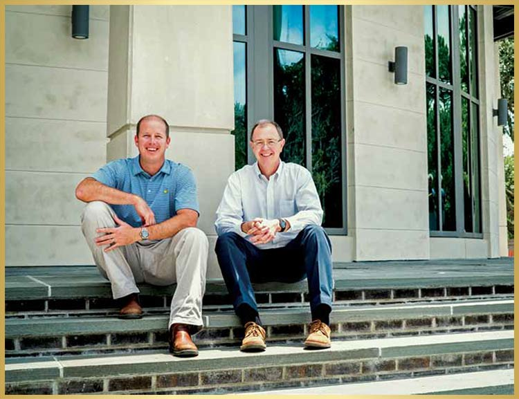 Project Manager Brooks Blumenthal, l e ft, and Architect Sam Herin on the front steps of Mount Pleasant 's new Town Hall.