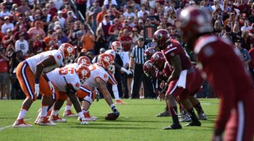 Making Their Communities Proud: Clemson and Carolina Football Players