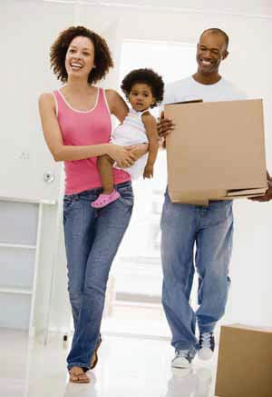 Home buyers: a couple moves into a new home