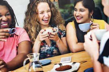 A group of gals celebrating over coffee and tea