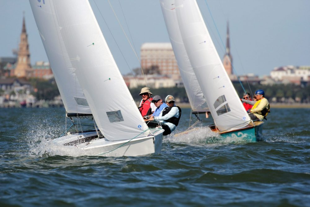 Sailboats race across the waters as the city of Charleston, SC sits pretty as the background