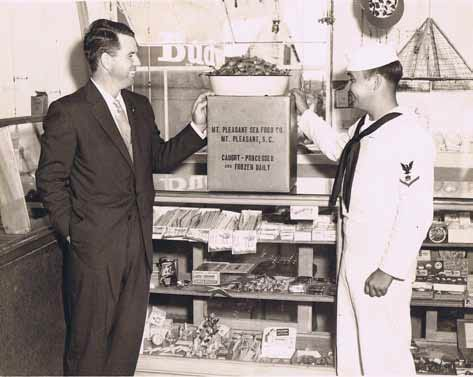 Walter D. Toler with a customer at Mount Pleasant Seafood in 1947.