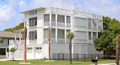 Lowcountry Hurricane Protection & Shutters. Photo of a home with hurricane protection