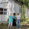 Pat Sullivan, Thomasena Stokes-Marshall and Freddie Jenkins in front of Long Point School, the last remaining African-American schoolhouse East of the Cooper.