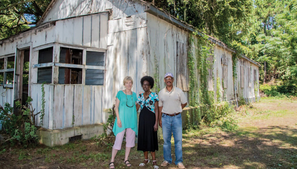 Pat Sullivan, Thomasena Stokes-Marshall and Freddie Jenkins in front of Long Point Elementary School, the last remaining African-American schoolhouse East of the Cooper.