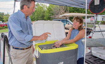 U.S. Rep. Mark Sanford talks with Pauline Blackwell of Lady J Shrimp at the Mount Pleasant Farmers Market. Facing page: Sanford discusses issues with Jeff and Ruth Lloyd.