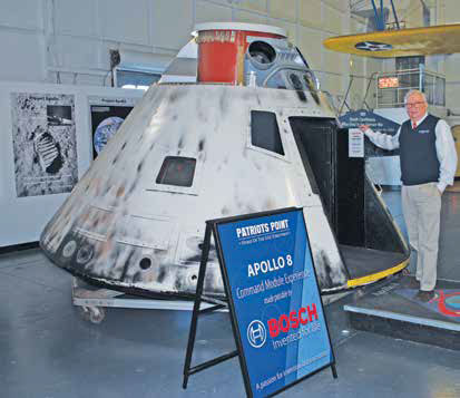 Burdette and the Apollo 8 replica that is now the most popular exhibit at Patriots Point.