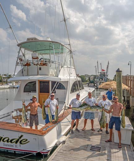 Everyone aboard The Renegade shows off some of their catch.
