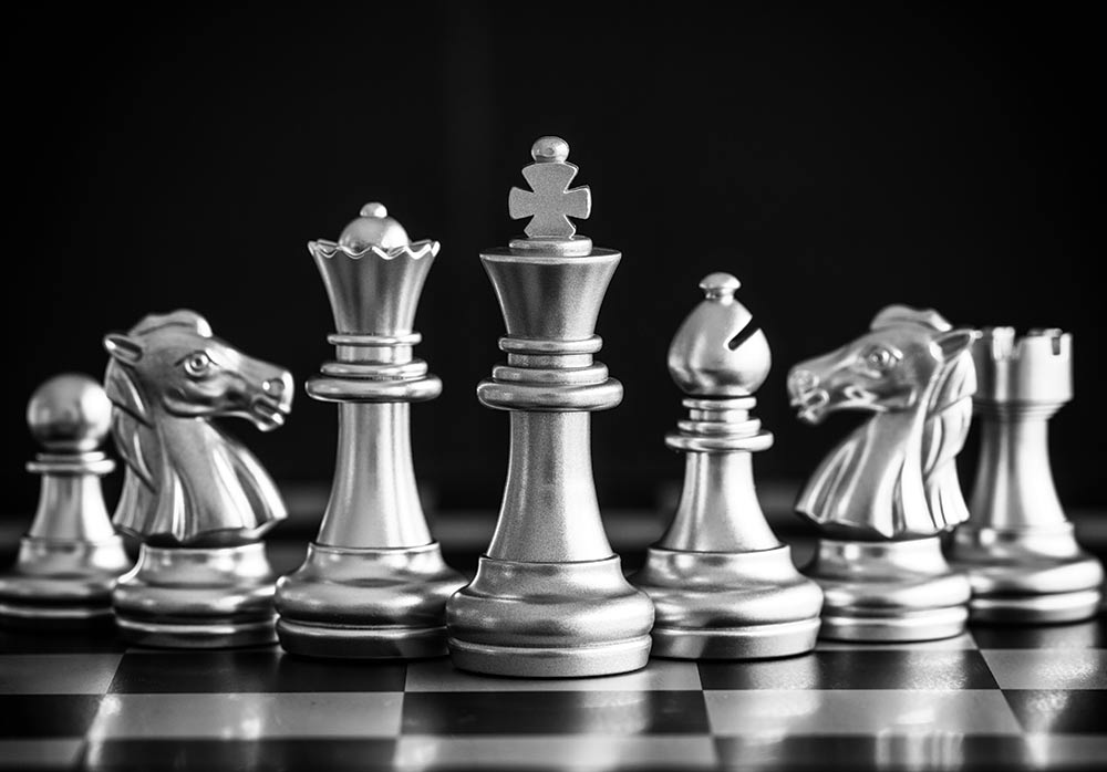 Photo of a chessboard for the 'Local Couples Conquering Business' article