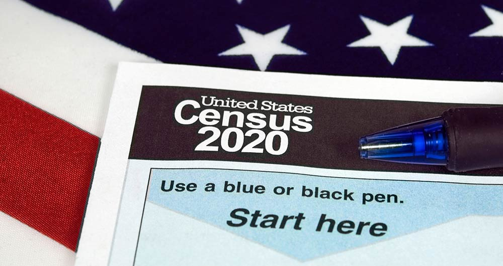 2020 Census form with an American flag in the background