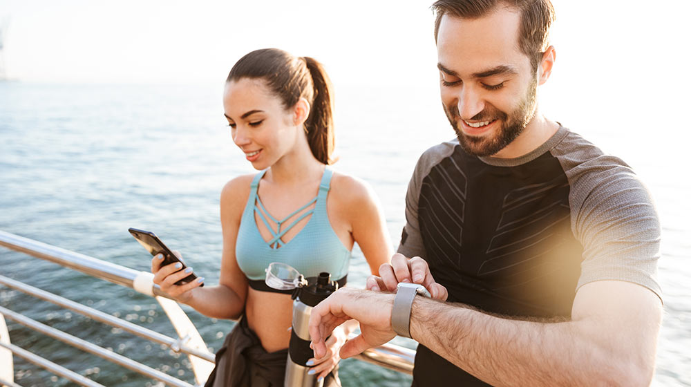 An active couple using an app to help manage exercise and burn calories