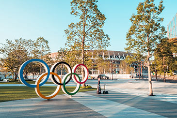 Tokyo Olympic Stadium seen in the background with the Olympic Rings in the foreground