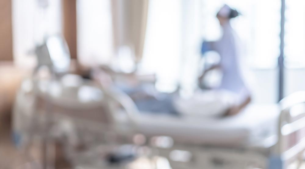 A blurry photo of a nurse with her patient in a hospital