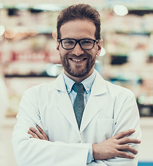 A pharmacist poses for a photo