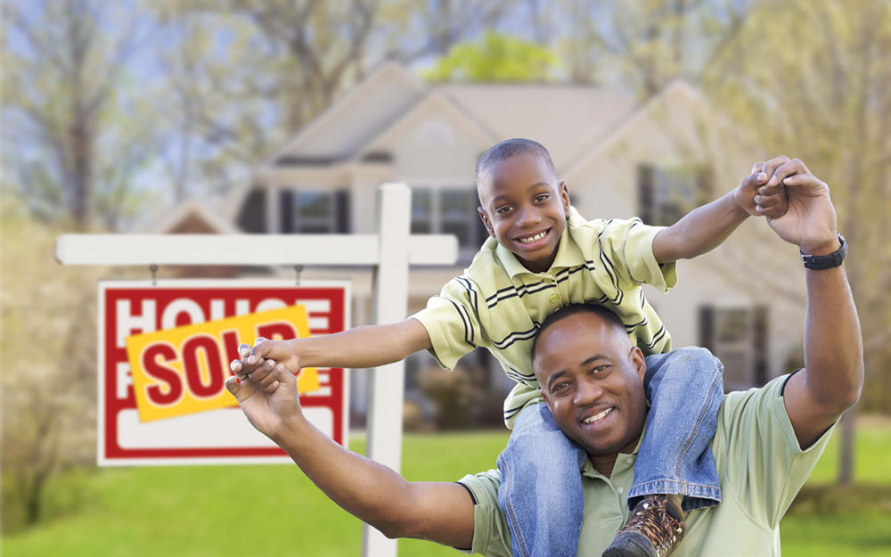 A son and his father smile after their house has been sold.