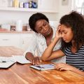 A mother helping her daughter, a stressed teenage student