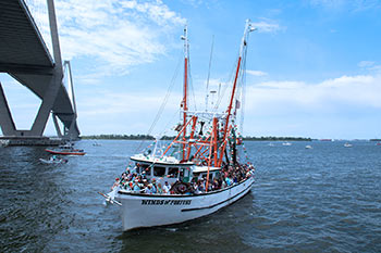 The Winds of Fortune sailing under the Ravenel Bridge during the Blessing of the Fleet.