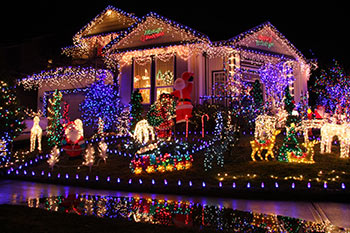 Christmas decorations light up a home at night.