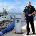 Police Chief Ritchie stands next to a new Mount Pleasant PD boat